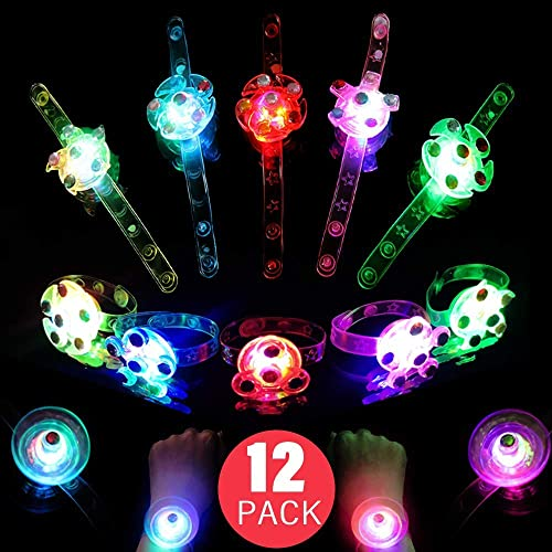 Ucradle Party Light Up Toys 28pcs LED Flash Spinning Party Favors for Kids LED Light Up Rings and Wristbands Glow In The Dark Party Supplies for Kids Boys Girls Prizes